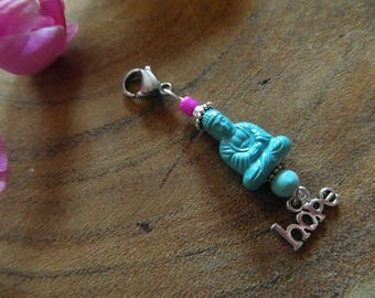 Gift to Gevenof to keep Buddha keychain with crown and charm