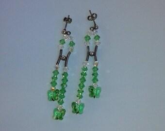 Swarovski crystal earrings Crystal Beads and Swarovski butterfly green peridot.  925 Silver hardware.