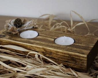 Gold wooden candle holder decorated with shabby chic method
