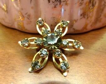 "Gold flower brooch with ""smoky quartz"" rhinestones"