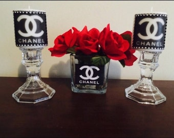 Custom designer Chanel candles and vase with flowers
