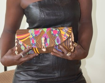 Clutch purse, cloth covered leather