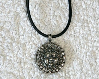 """SHUNGIT PENDANT """"SUN"""" (jewelry melt with silver 40 microns and swarovsky crystals)."""