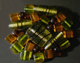 26 orange, amber, green of various shapes Indian glass beads