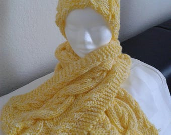 More scarf wool hat with cables in patterns of yellow hand knit