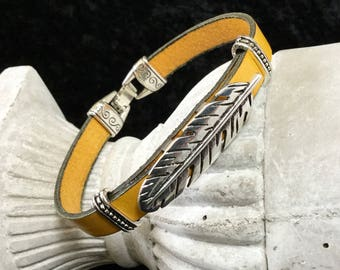 Mixed yellow leather pass-leather bracelet feather
