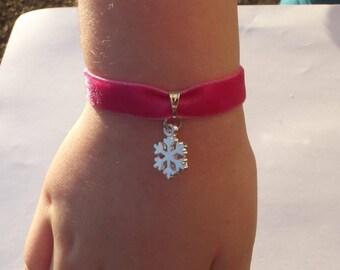 Child bracelet silver snowflake charm and pink velvet fabric.