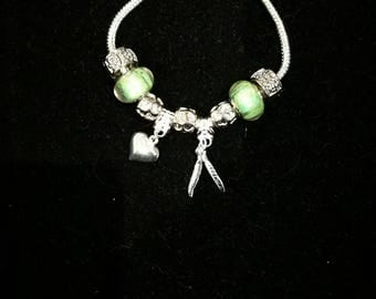 European bracelet with green, heart beads, feathers