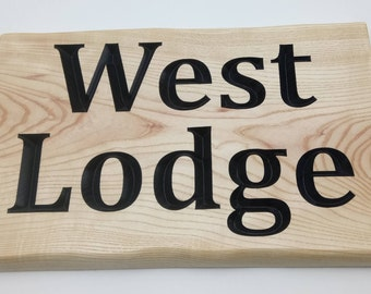 Wood carved house sign plaque in Ash