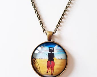Sidney Nolan 'Ned Kelly', 30mm round pendant in silver or antique bronze, includes complimentary chain