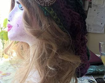 gorgeous hand crocheted slouch hat in blues and purples