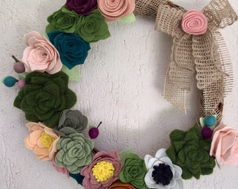 Welcome wreath with flowers and succulents of felt