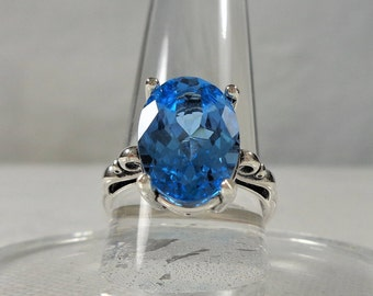 Swiss blue topaz ring  5.5ct (14x10mm) oval  sterling silver scroll setting  size 7.5