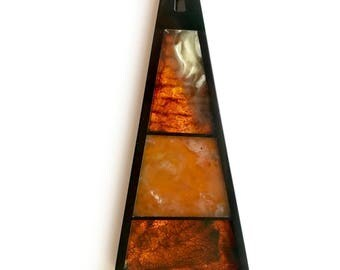 Pendant of amber and Gagat in abstract style