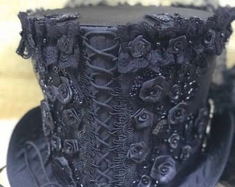 Black front corseted Satin top hat with jewels,pearls and back bustle available in 3 sizes  58cm,59cm, 60cm