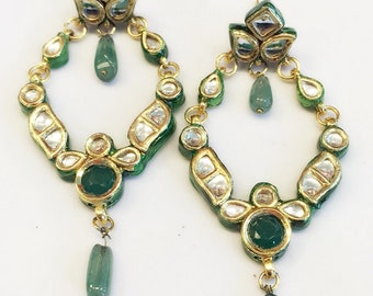 Green stone with kundan chained chandlier with a green bead dangling