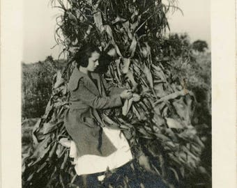 vintage photo 1920 Teen Girl Sits in Corn Field Tall Stacked Stalks