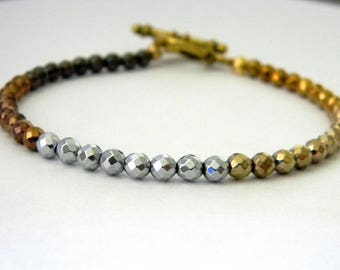Mixed Metal Hematite Beaded Bracelet Gold Toggle Clasp