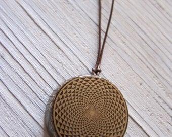Mandala Energy Pendant. Shungite, black tourmaline, amethyst, rose quartz copper spiral epoxy resin.
