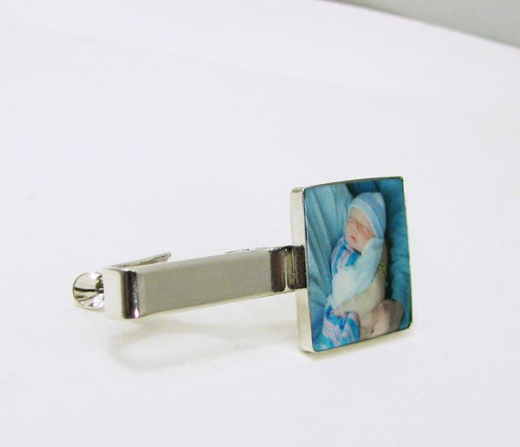 A sterling silver tie clip with a photo tile, and an engraveable bar.