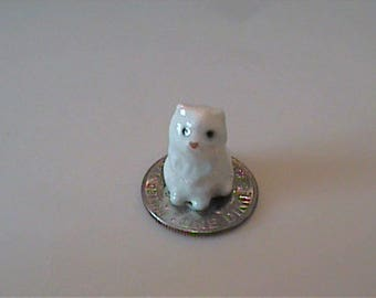 Vintage 1976 miniature Hagen Renaker tiny white chair sits on blue chair