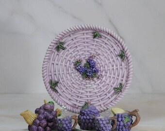 Vintage collectible miniature grape theme tea set. Platter, tea pot, sugar bowl, creamer, two tea cups on grape leaf saucers. Lids attached