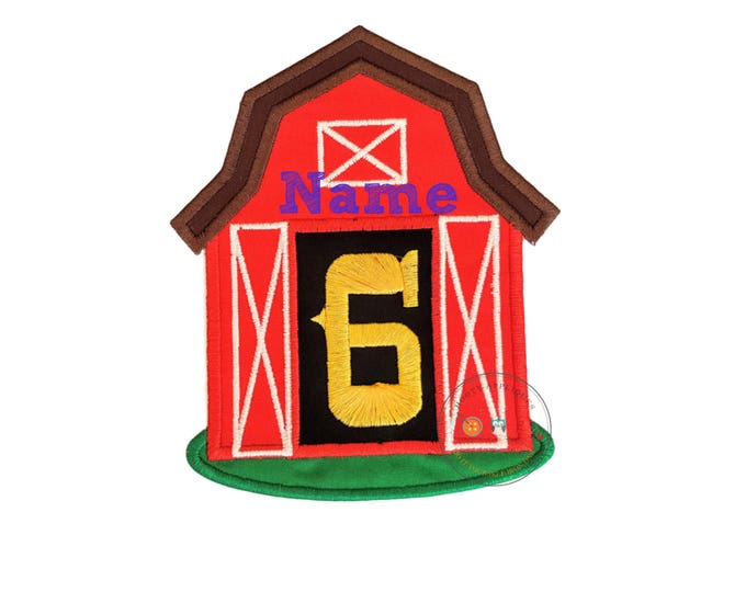 Red, country barn iron on applique with open doors displaying a big, yellow, birthday number 6 on top of a black back ground, white details