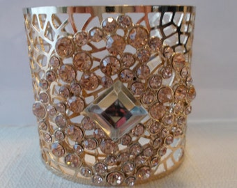 Gold Tone Filigree Cuff Bracelet with Gold Rhinestones and a Gold Center Bead