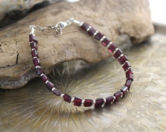Garnet gemstones and silver bracelet
