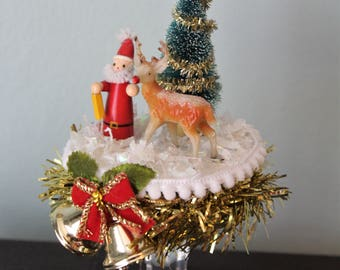 Christmas scene assemblage with Santa Claus, Rudolph the reindeer and Christmas tree
