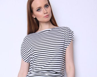 Unique blouse with wavy details in waist area