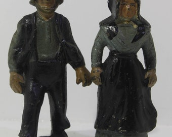 Vintage cast iron Amish man and woman