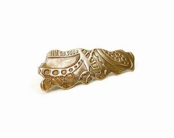 Pince à cheveux motifs ethniques en bronze doré