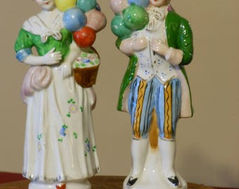 Colonial Figurines with Balloons
