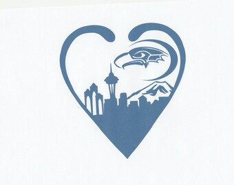 Seattle skyline in heart with seahawk moon