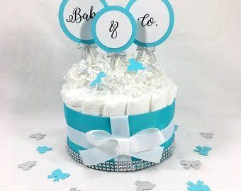 Aqua, White, and Silver Baby & Co Girl Diaper Cake Centerpiece, Girl Baby Shower Diaper Cake