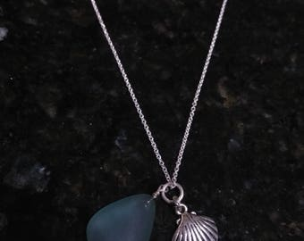 Blue/green Sea glass with a silver charm dangle on an adjustable silver chain