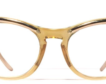 Vintage eyewear. Cat eye style. 1950's Bronze Aluminum detailing across brow and sides. Pretty Midcentury modern style. Great condition!