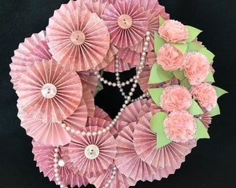 pink paper rosette wreath with pink carnations and beads