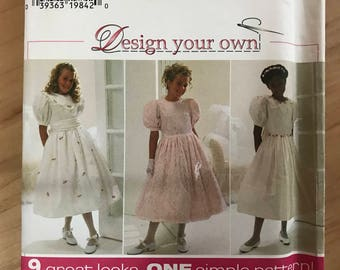 Simplicity 7487 - Design Your Own Girl's Party Dress with Short Puff Sleeves and Flared Skirt - Size 7 8 10