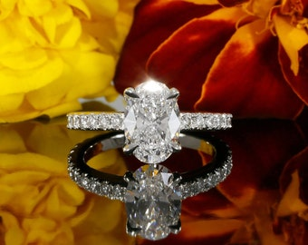 9x7mm Oval Colorless Forever One Moissanite Solitaire Diamond Engagement Ring in 14K White Gold (avail. in rose, yellow gold and platinum)