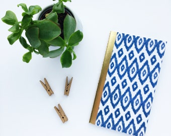 Blue and white patterned notebook