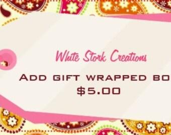 ADD a gift wrapped box