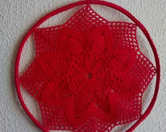 Christmas decorations, made of crochet with red coloured cotton thread.