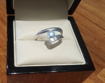 Handmade sterling silver and cubic zirconia ring