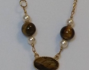 Small tiger eye medallion with pearls