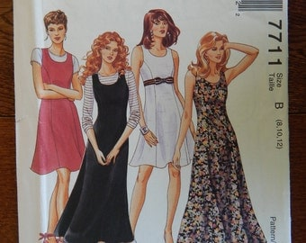 Dress or Jumper Sewing Pattern Princess Seams/ McCalls 7711/ Misses Size 8, 10, 12/ flared skirt, back zipper, sleeveless/Uncut