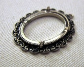 Silvertone cab frame pendant settings for 20 x 30 mm cabs.  With antiqued ornate edging. Supply. FREE SHIPPING