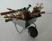 Dolls house metal wheelbarrow hand filled with garden goodies