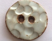 Milky white and rustic, textured, round circular 1 and 3/8-inch, one-of-a-kind, handmade in Maine stoneware ceramic button